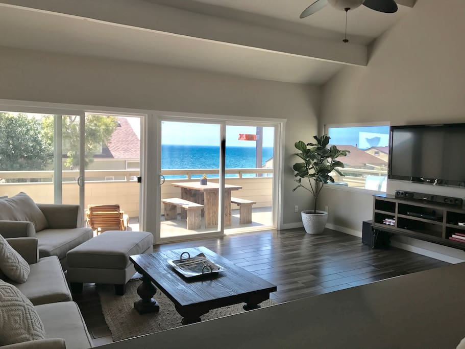 Second floor great room living room with ocean views, double glass sliding doors for maximum light and views. Roll down shades on exterior of sliding doors