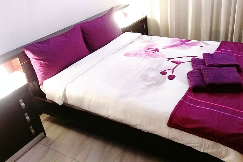 Medium size bedroom with double bed with firm Italian mattress and memory foam bamboo pillows.