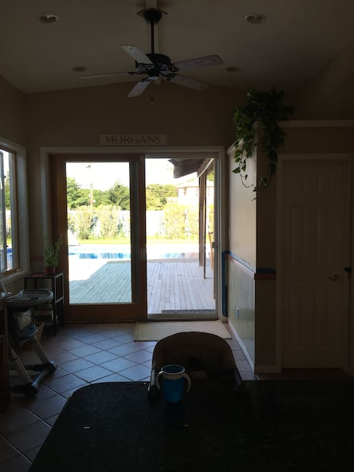 Extra large sliding glass doors lead outside to the deck and provide superb morning sunlight