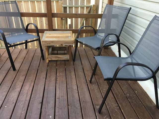 Seating space on back deck with cute little homemade table for snacks/bevies.