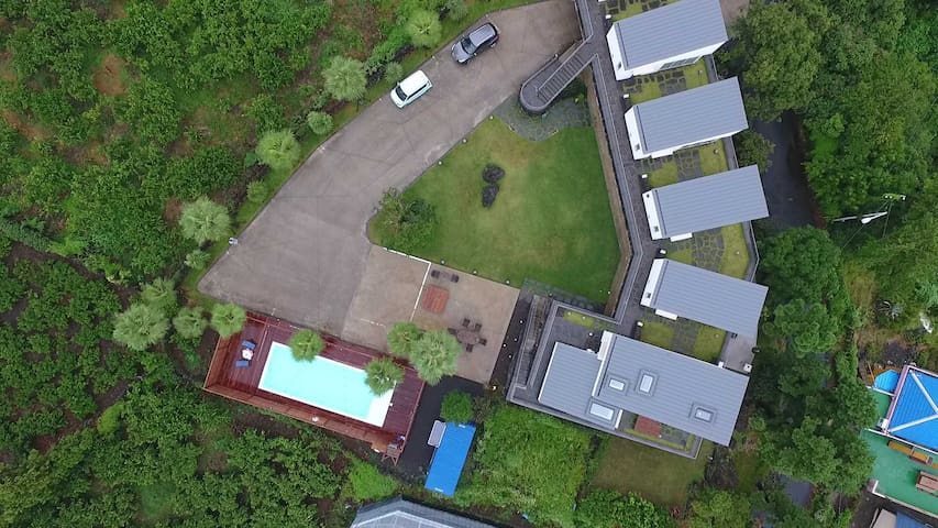 Sky view! Each unit is separate and private. Swimming pool besides the tangerine farm.