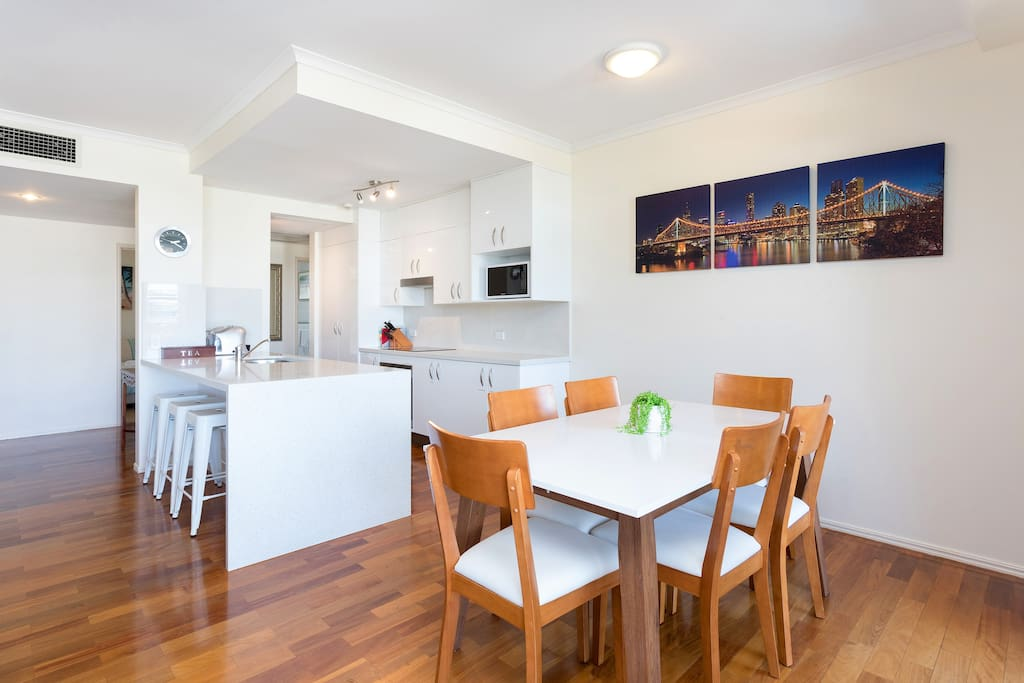 Dining room and kitchen with Brisbane river views.