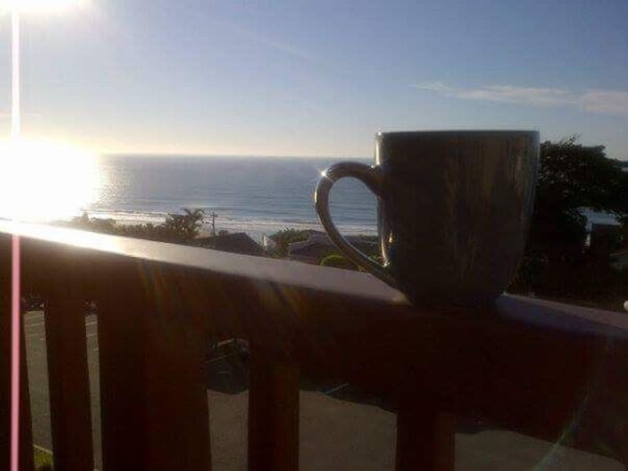 Have a coffee while you enjoy the sunrise over the ocean.