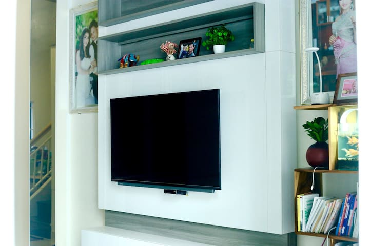 A living room which equip with a Cable TV.