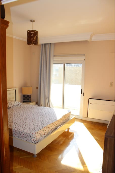 1st large bedroom with air con, wardrobe and balcony, suitable for 2 guests