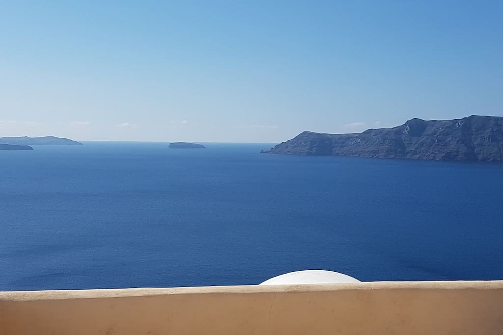 Unique view of Santorini's Volcano, Caldera and Thirasia Island.
