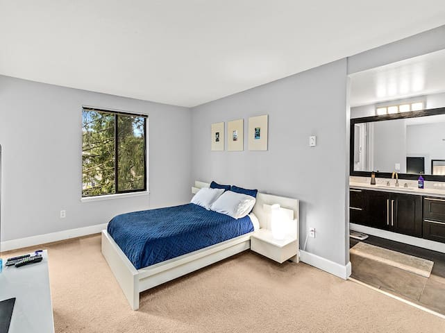 Master bedroom with in suite bathroom that has access to the balcony.