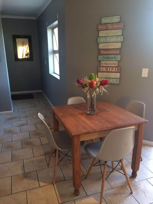 A 4 seater dining table brings the living area and workspace in the hallway together.