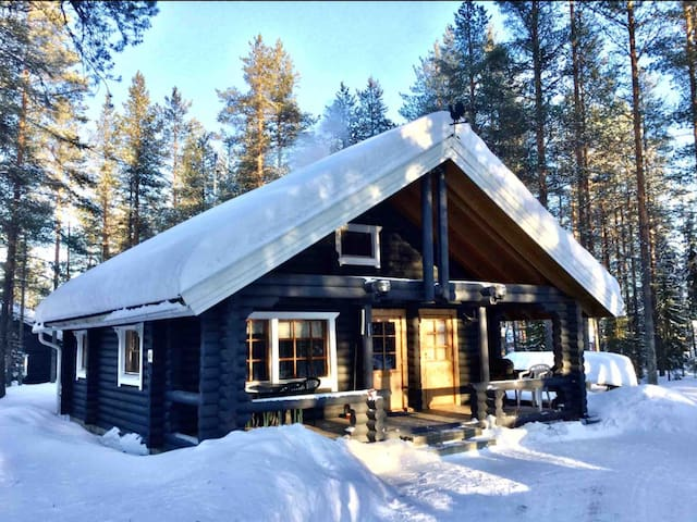 Log cabin with wood-heated sauna and barbecue hut
