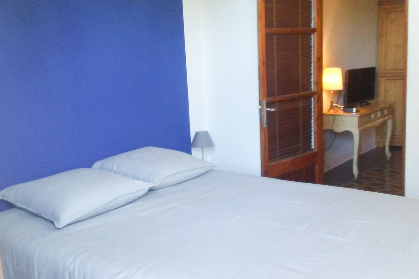 Bedroom with double bed, ensuite bathroom and lounge.
