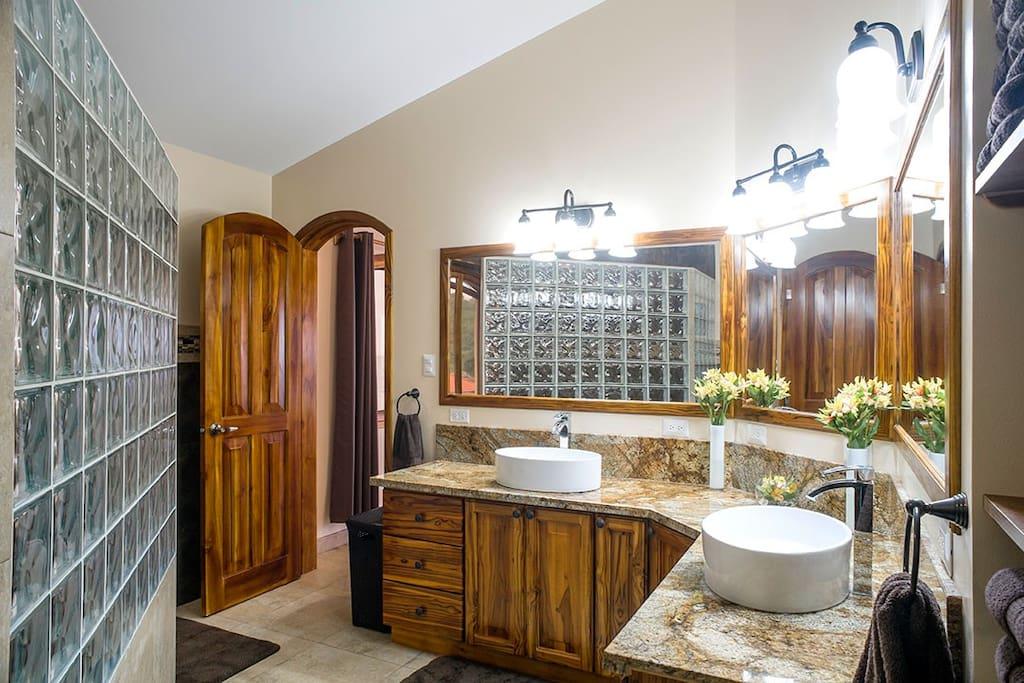 En-suite bathroom - 12' teak vanity with granite top, double sinks and triple mirrors.