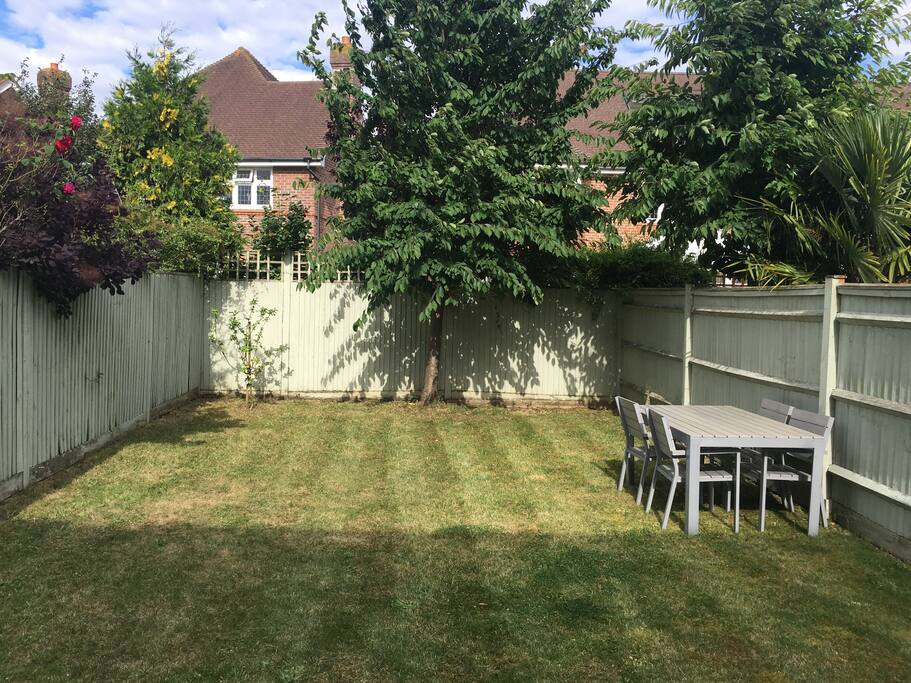 Sunny garden with table and chairs.  BBQ available if required.