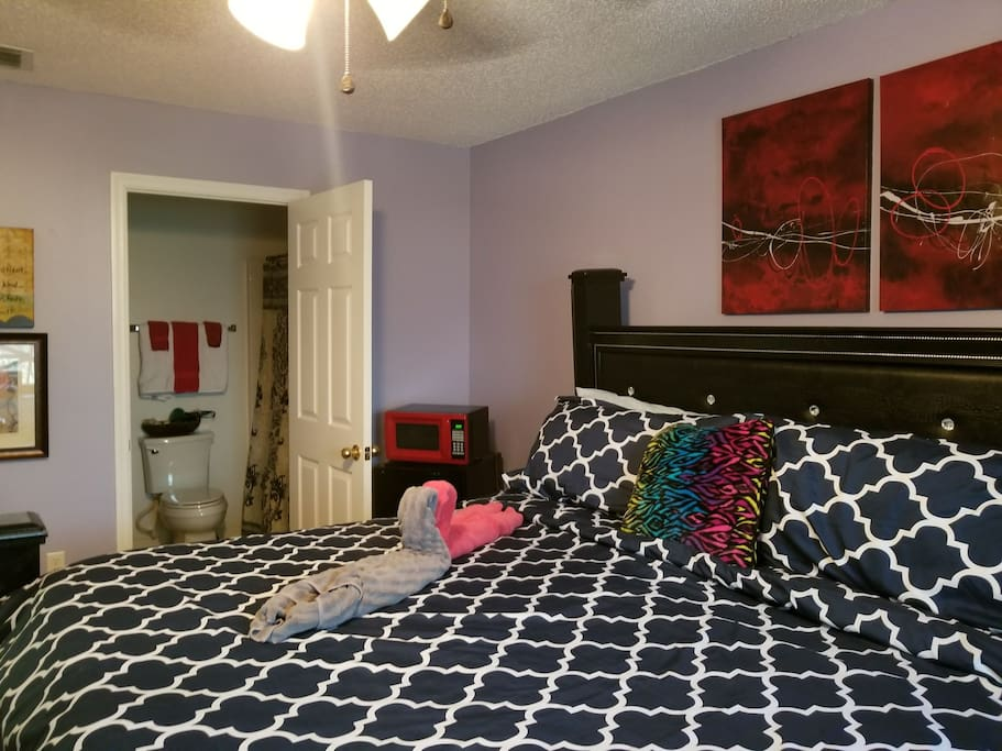 This is our King Bedroom.  Very comfortable!  Private Bath with shampoo and conditioner, towels hair dryer and pool towels as well. You'll have a Flat screen TV, Refrigerator,  Microwave and a 2 luggage racks for each suitcase.   Super comfy!
