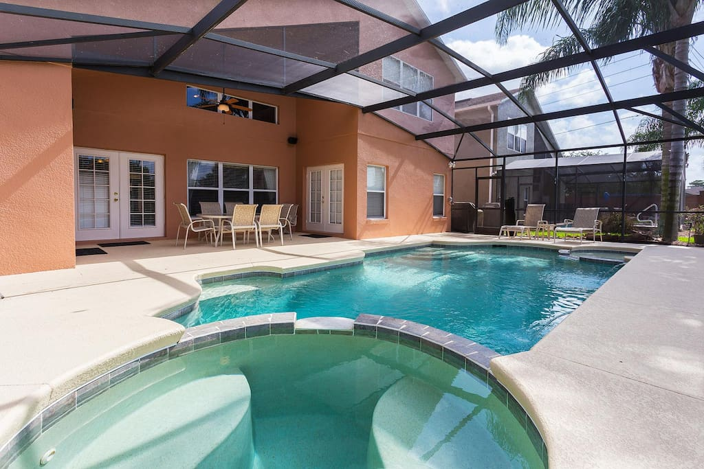 South-facing private pool with spillover spa, luxury patio furniture, pool shower & gas barbecue grill