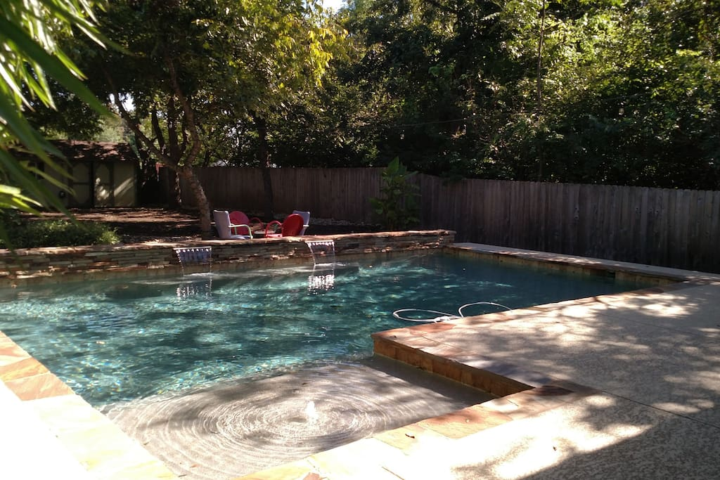 Pool deck and yard view.