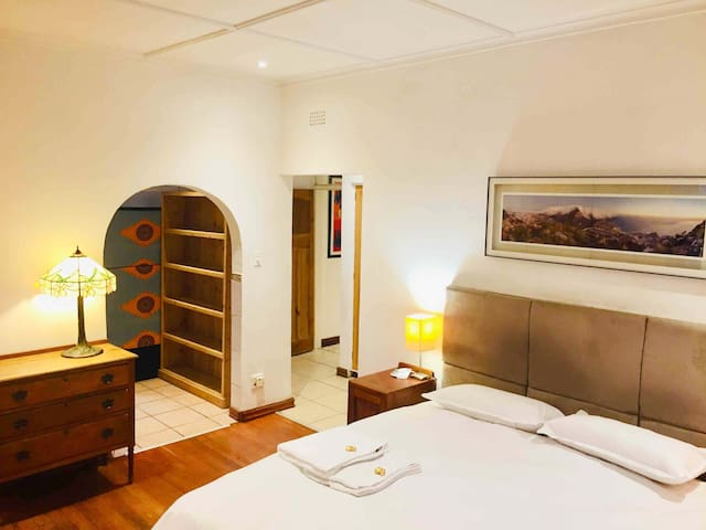 Main bed boasts a King size bed with en suite bathroom, air conditioning, sauna bath and french doors opening up onto the patio and pool.