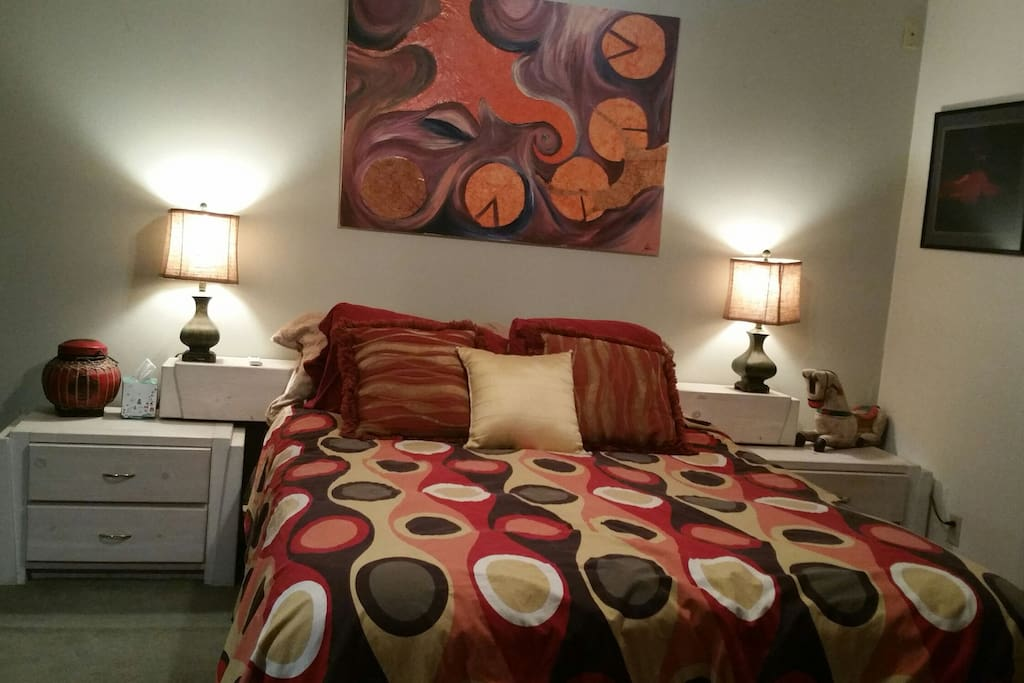 Bedroom has that bright, comfortable 1960's colors and style