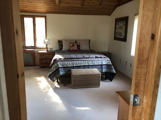 1st master suite with queen sized bed.  Vaulted Ceiling large closet, full bath, great views.