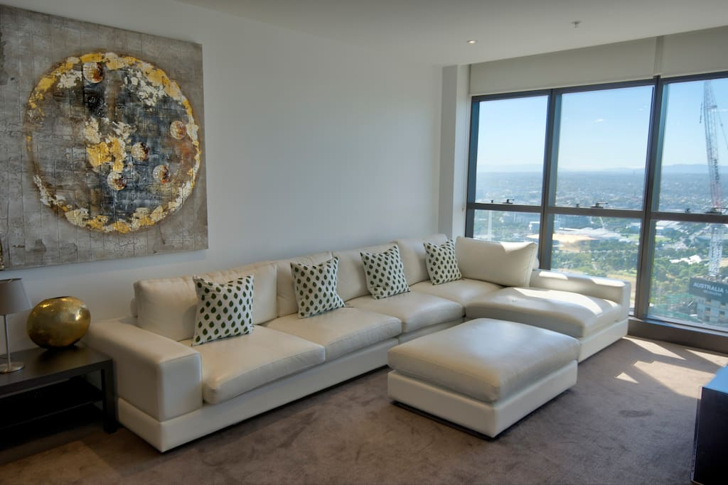 Main Lounge, apartment on level 52...Amazing views overlooking the City, MCG and Australian Open tennis centre
