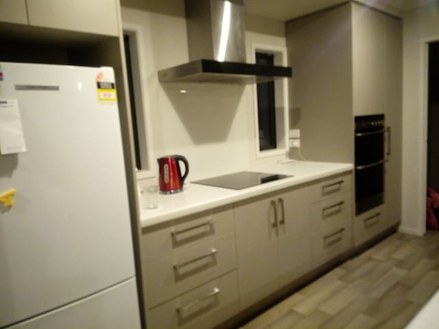 Double oven and induction hobtop. All the essential like microwave, toaster, big, cake mixer, oven dishes, dishwasher, fridge freezer.