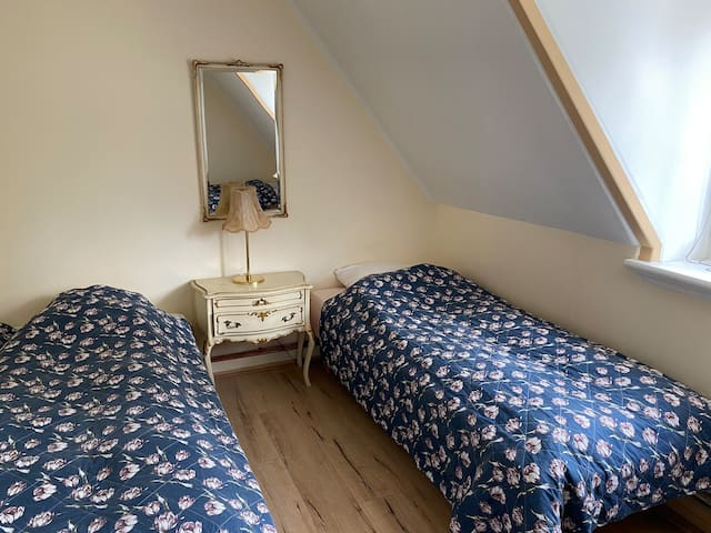 Room 4. Double room with two single beds.