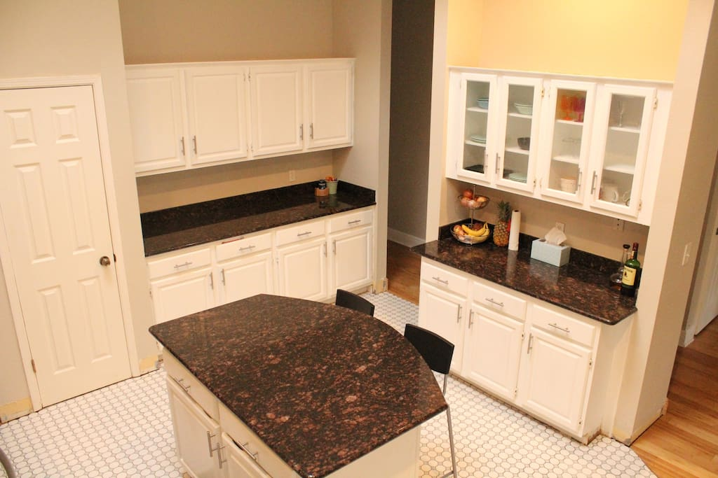 kitchen island, cabinets and pantry