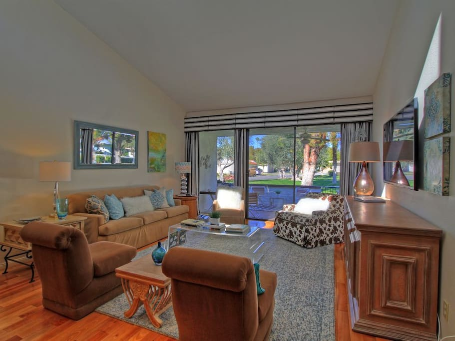 Living Room, large flat screen TV, door to large patio, open to dining area