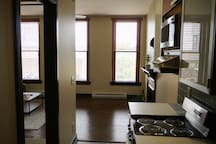 Kitchen w/ easy access to the bedroom and living space
