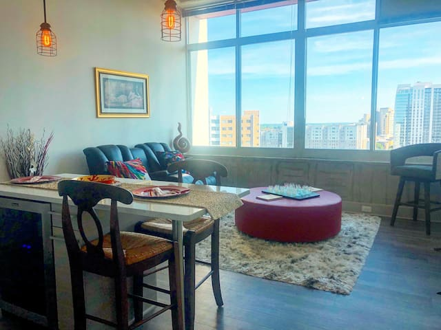 Exact Photo of the Living Room with Skyline View