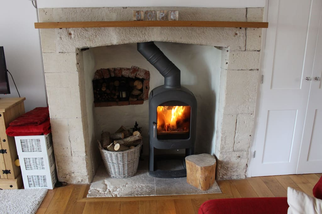 Period stone fireplace with wood burning stove