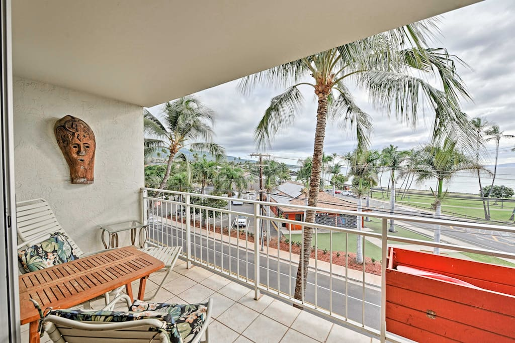 Enjoy tropical views of swaying palm trees and the ocean from the private lanai.