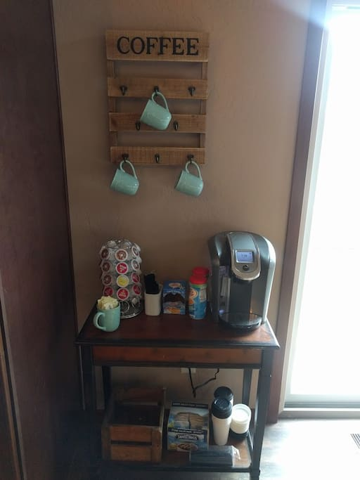 Coffee bar with a Keurig 2.0 & stocked K-cups and creamer/sugar.