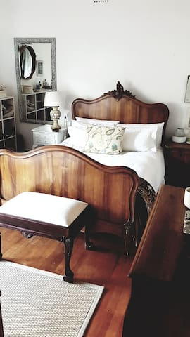 Really crisp and clean cotton linnen on an antique bed, falling asleep listening to the ocean