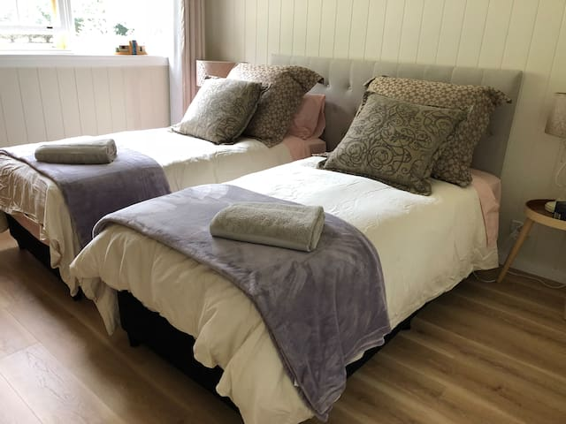 Bedroom 2 can change from a king size bed to 2 singles. Let us know what you need when you make your booking.