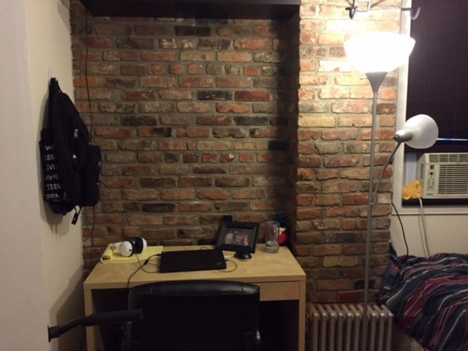 exposed brick wall of room