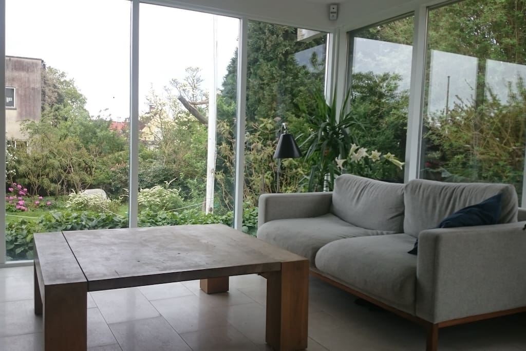One of the living rooms with a view of the garden