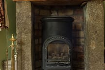 Feature fireplace with coal effect gas fire (propane). The cottage has full modern CH.
