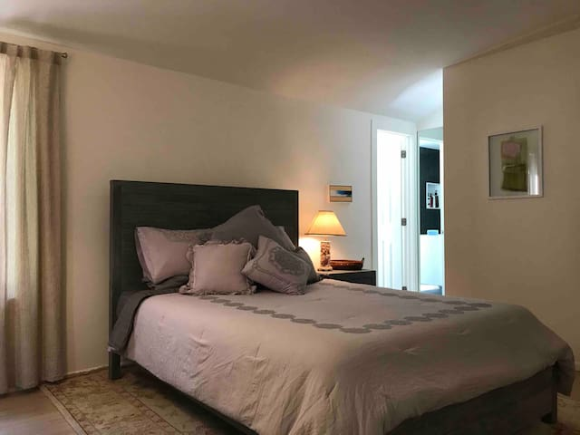 Master bedroom Includes full dresser, side table, closet and attached master bathroom.  Spare pillows, iron and small ironing board are located in your closet.