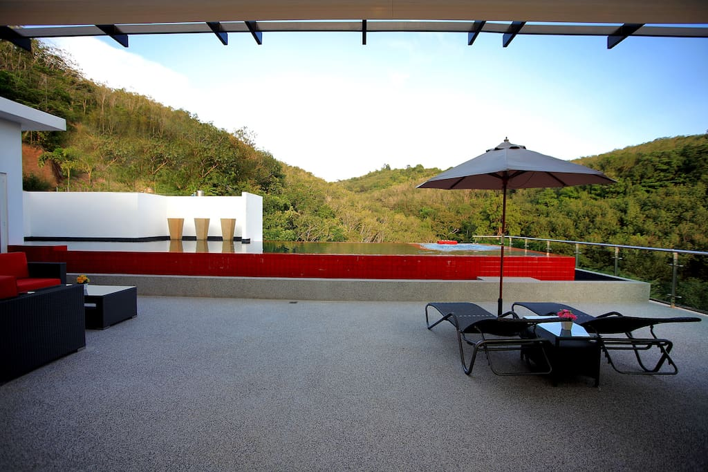 The spectacular pool with a breathtaking view of the hills