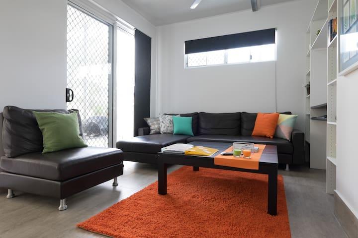 Loungeroom with screened doors.