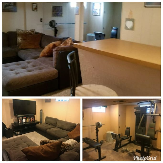 Cozy fully finished basement with bar, exercise area, and tv area.