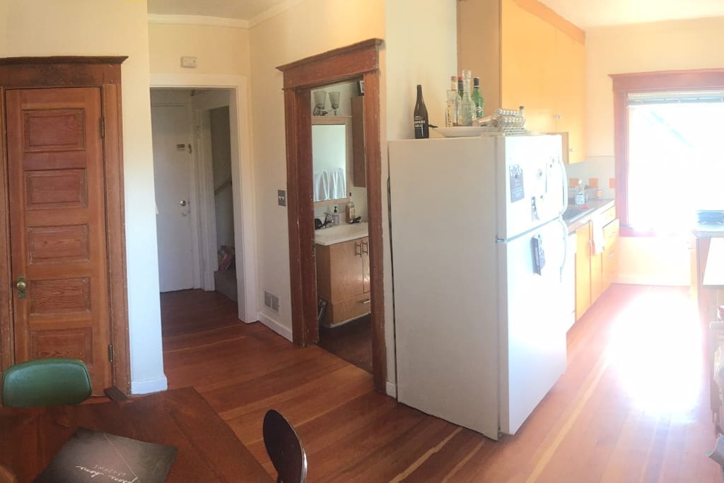 The main floor of our apartment has a small breakfast nook and kitchen (fully stocked with dishes, flatware, glasses. and kitchen gadgets).