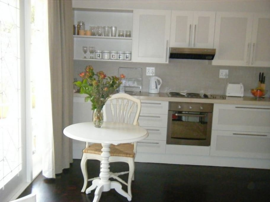 The Zola Suite: full well-equipped kitchen, having a full oven and hob, microwave, large fridge & freezer