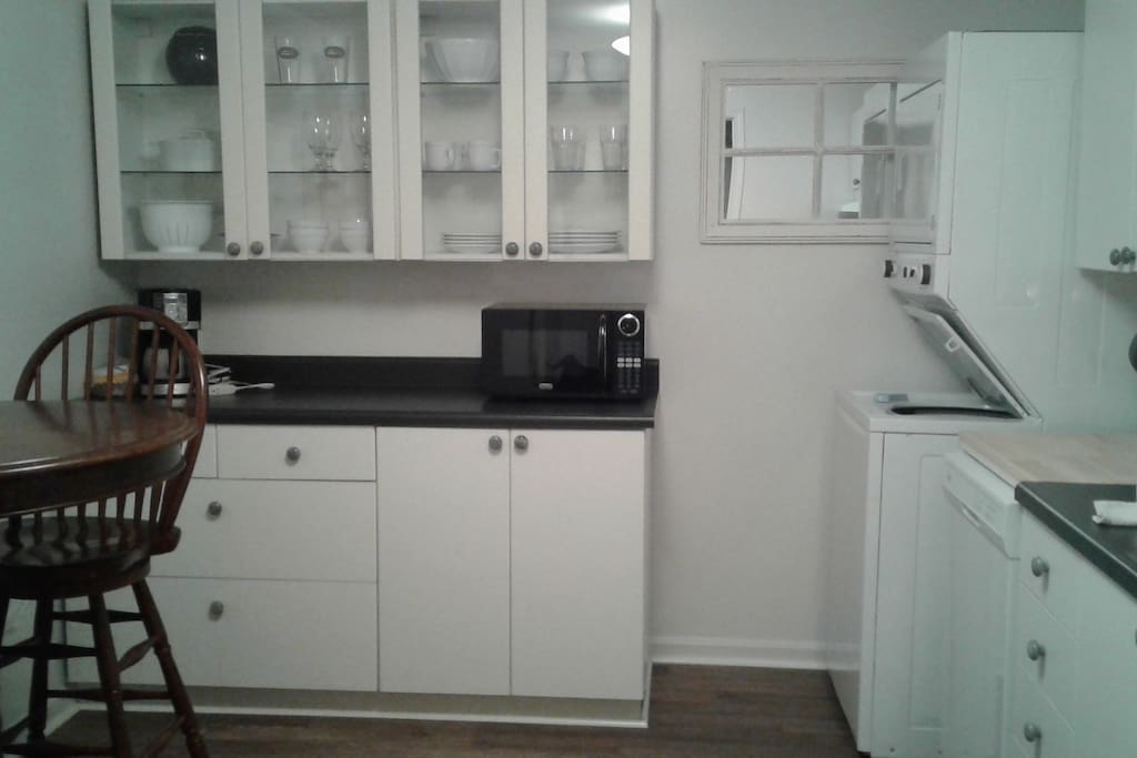 Fully equipped kitchen with full size fridge, stove and laundry