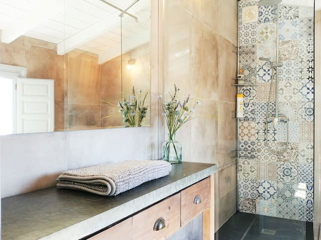 Luxurious Shower Room - overhead 'rainforest' shower, porcelanica Andalusian tiles, original wooden windows and shutters and a stunning view of the mountains and olive groves below