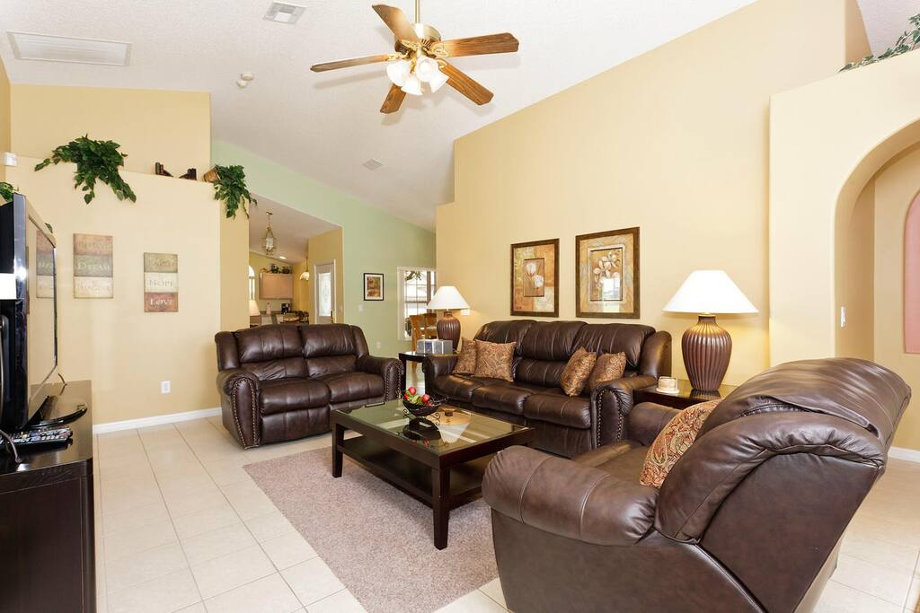 Gather for a movie favorite in the spacious living area with 50-inch flat-screen TV, PlayStation 2 and more