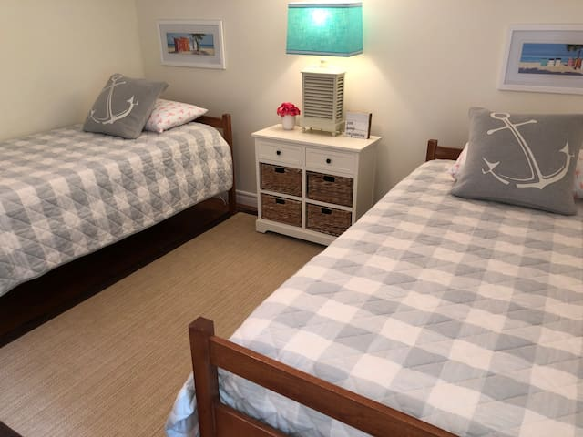 Spacious loft bedroom with two twin beds and new mattresses.