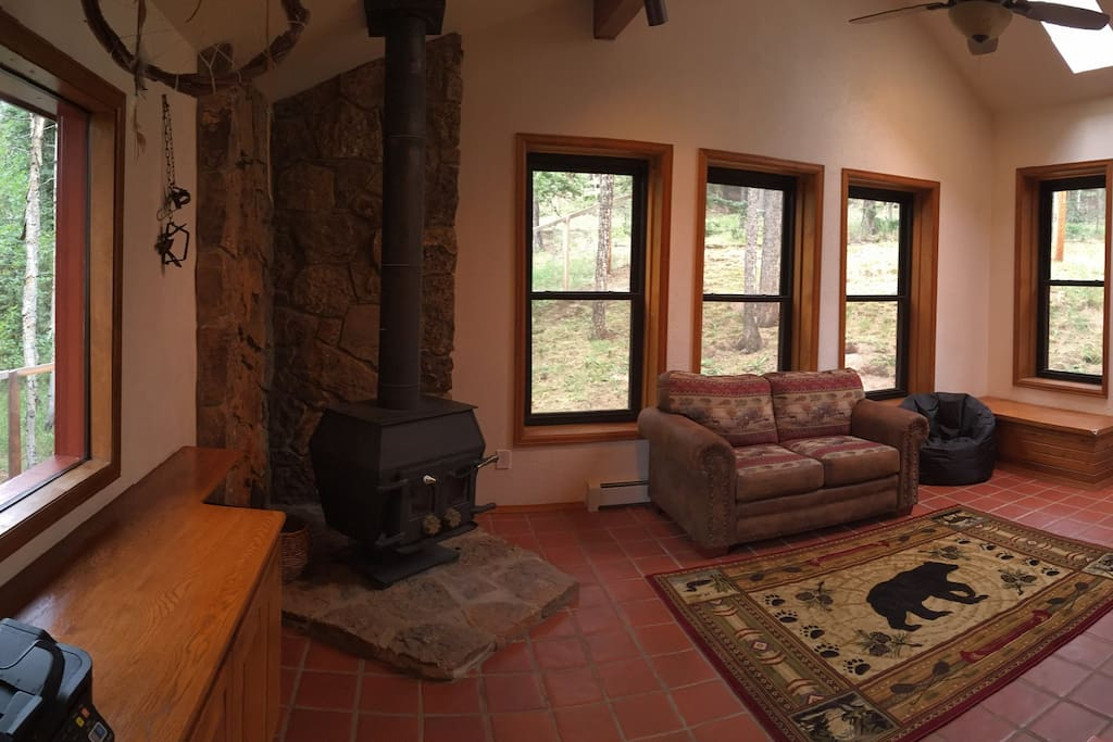 Sun room/Family room. Stay warm With the wood-burning stove enjoy the woodland views in the summer. This room is stuffed full of toys and games for family fun.