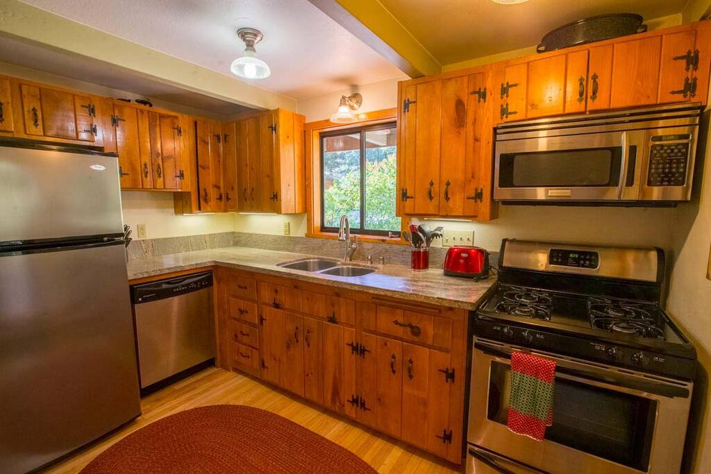 Full kitchen with range/stove, microwave and dishwasher.