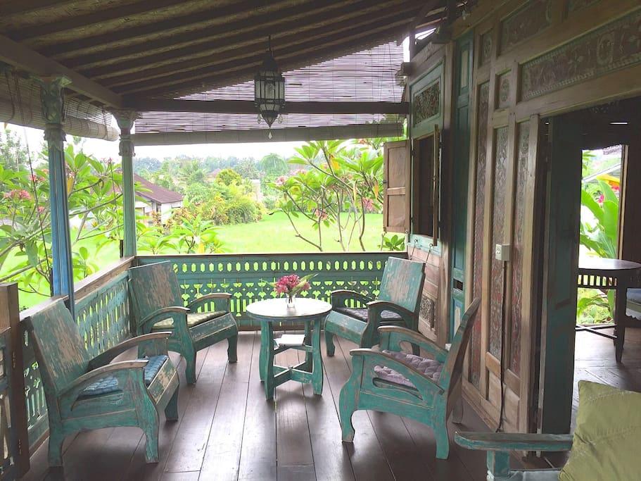 """Sitting on the veranda, old Java """"Sedan"""" furniture."""